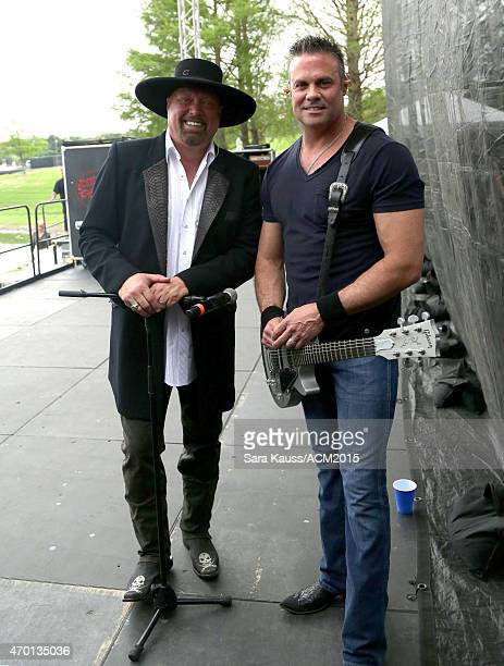 Singers Eddie Montgomery and Troy Gentry of Montgomery Gentry pose backstage during the ACM Party For A Cause Festival at Globe Life Park in...