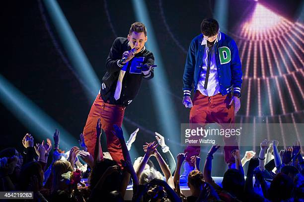 Singers Eiko and Denny perform during the second Semifinal of 'Das Supertalent' TV Show on December 07 2013 in Cologne Germany