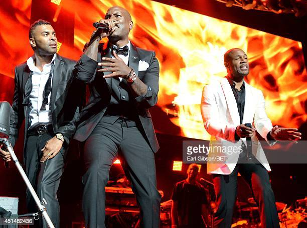 Singers Elgin Baylor Lumpkin aka Ginuwine Tyrese Darnell Gibson aka Tyrese and Durrell Babbs aka Tank of TGT perform onstage at the Mary J Blige Trey...