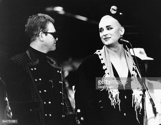Singers Elton John and Boy George on stage together at a Prince's Trust concert Wembley Stadium London June 9th 1987