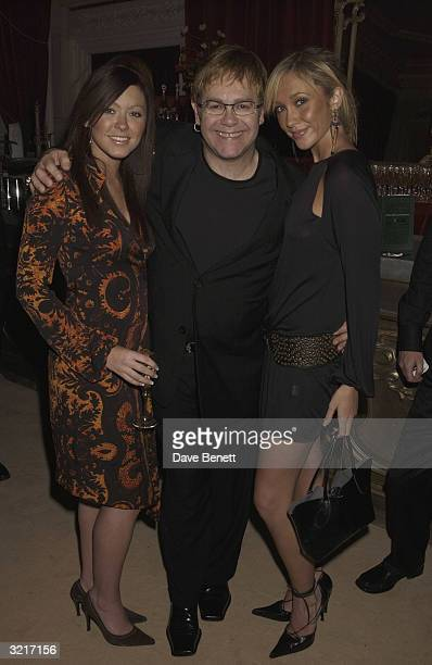 Singers Elton John Natasha Hamilton and Jenny Frost from the pop group Atomic Kitten at the PerrierJouet Belle Epoque party in aid of The Elton John...