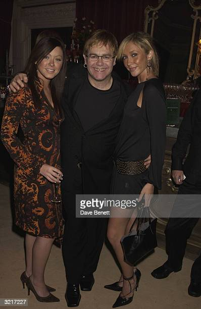 Singers Elton John Natasha Hamilton and Jenny Frost of the pop group Atomic Kitten at the PerrierJouet Belle Epoque party in aid of The Elton John...