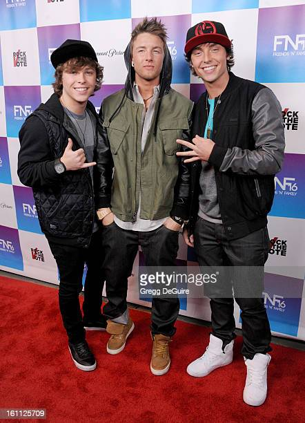 Singers Emblem3 Wesley Stromberg Keaton Stromberg and Drew Chadwick arrive at The Grammy Awards Friends 'N' Family party at Paramount Studios on...