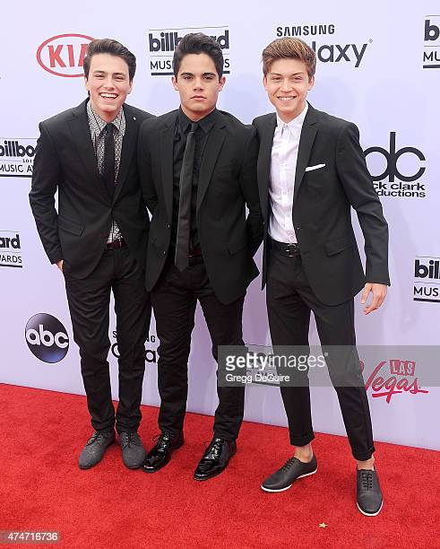 Singers Emery Kelly Ricky Garcia and Jon Klaasen of Forever In Your Mind arrive at the 2015 Billboard Music Awards at MGM Garden Arena on May 17 2015...