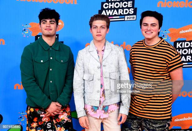Singers Emery Kelly Ricky Garcia and Liam Attridge attends Nickelodeon's 2018 Kids' Choice Awards at The Forum on March 24 2018 in Inglewood...