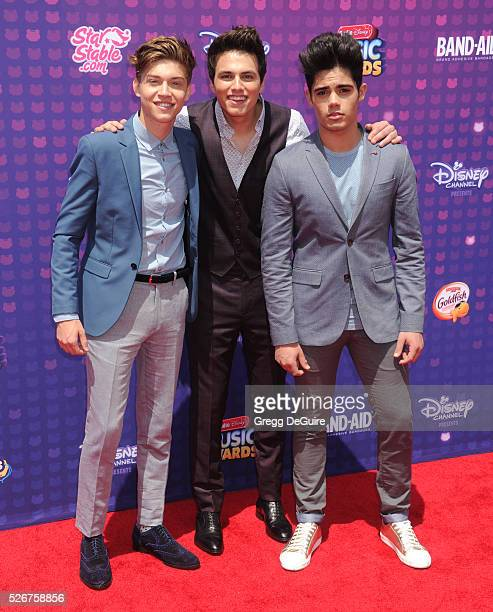 Singers Emery Kelly Ricky Garcia and Liam Attridge of Forever In Your Mind arrive at the 2016 Radio Disney Music Awards at Microsoft Theater on April...