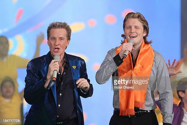 Singers Emmanuel and his son Alexander Acha perform on stage during the Teleton 2011 TV broadcast at Televisa San Angel on December 2, 2011 in Mexico...