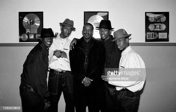 Singers Eric McNeal Keith Thomas Trerail Puckett and Roy Jones of Subway poses for photos with their choreographer Brooke Payne at WGCIFM radio in...