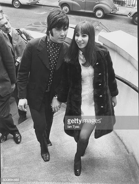 Singers Esther and Abi Ofarim arriving at their hotel in Britain circa 1965