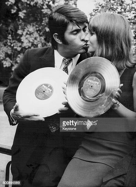 Singers Esther and Abi Ofarim posing with their two golden discs to celebrate 500000 record sales Castle Tremsbuttel Hamburg September 14th 1966