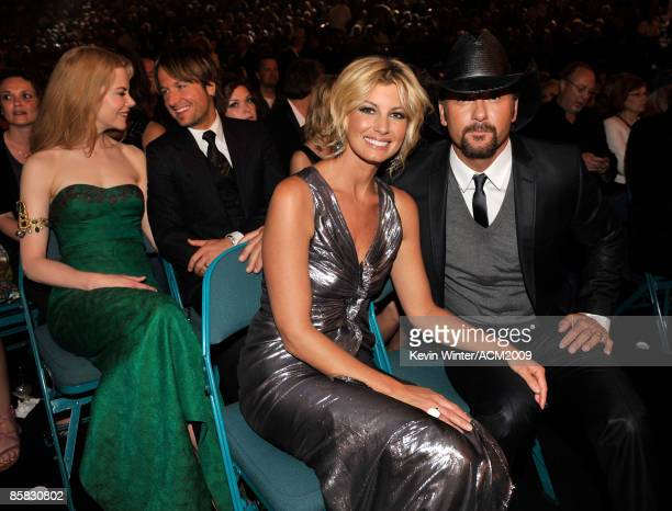 Singers Faith Hill and Tim McGraw and actress Nicole Kidman and performer Keith Urban pose in the audience during the 44th annual Academy Of Country...