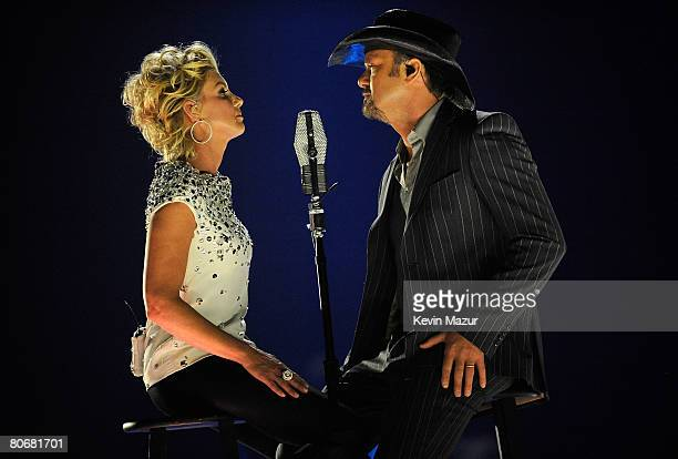 "Singers Faith Hill and Tim McGraw perform ""I Need You"" onstage during the 2008 CMT Music Awards at the Curb Event Center at Belmont University on..."