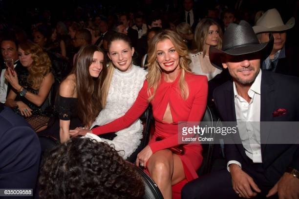 Singers Faith Hill and Tim McGraw with daughters Audrey McGraw and Maggie McGraw attend The 59th GRAMMY Awards at STAPLES Center on February 12 2017...