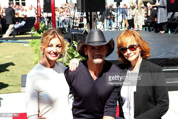 Singers Faith Hill Tim McGraw and Reba McEntire poses for photos after Tim received his star on the Music City Walk of Fame in 'Walk of Fame Park' in...