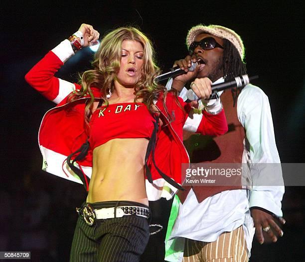 Singers Fergie and william of the Black Eyed Peas perform at 1027 KIISFM's Wango Tango OnAir 2004 at the Rose Bowl May 15 2004 in Pasadena California