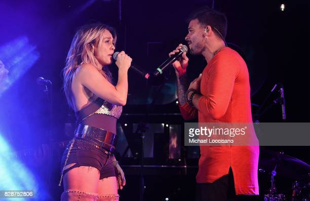 Singers Fey and Pedro Capo perform during HBO Latino x Pedro Capo En Letra de Otro at La Marina Restaurant Bar Beach Lounge on August 9 2017 in New...
