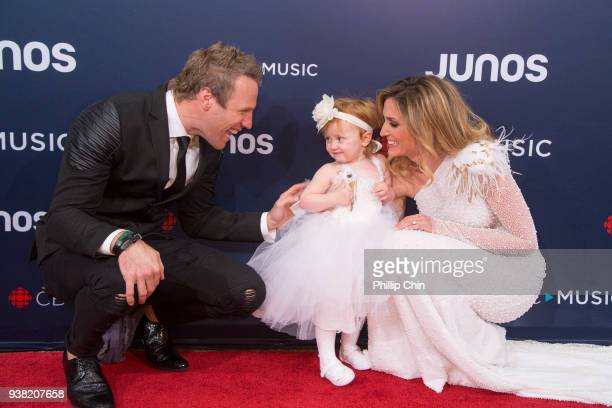 Singers Fraser Walters and Kelly Levesque play with their daughter Hope at the red carpet arrivals at the 2018 Juno Awards at Rogers Arena on March...