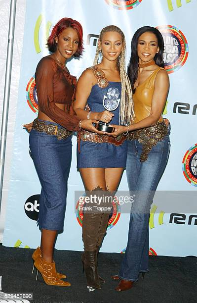 Singers from 'Destiny's Child' Kelly Rowland Beyonce Knowles and Michellle Williams with their awards