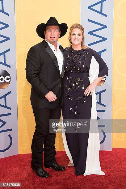 Singers Garth Brooks and Trisha Yearwood attend the 50th annual CMA Awards at the Bridgestone Arena on November 2 2016 in Nashville Tennessee