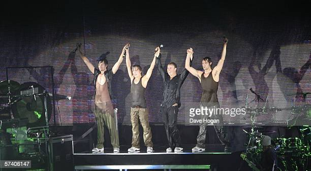 Singers , Gary Barlow, Howard Donald, Jason Orange and Mark Owen of Take That perform on stage at the band's opening night of their 'Ultimate Tour...
