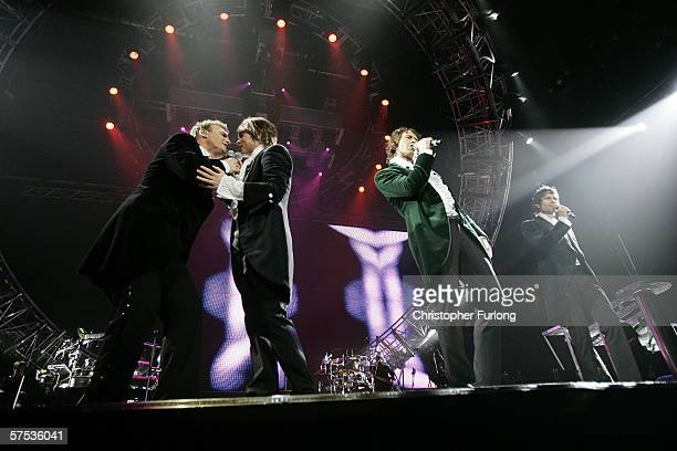 Singers Gary Barlow, Mark Owen, Howard Donald and Jason Orange of Take That perform onstage as part of the band's Ultimate Tour 2006 at Manchester...