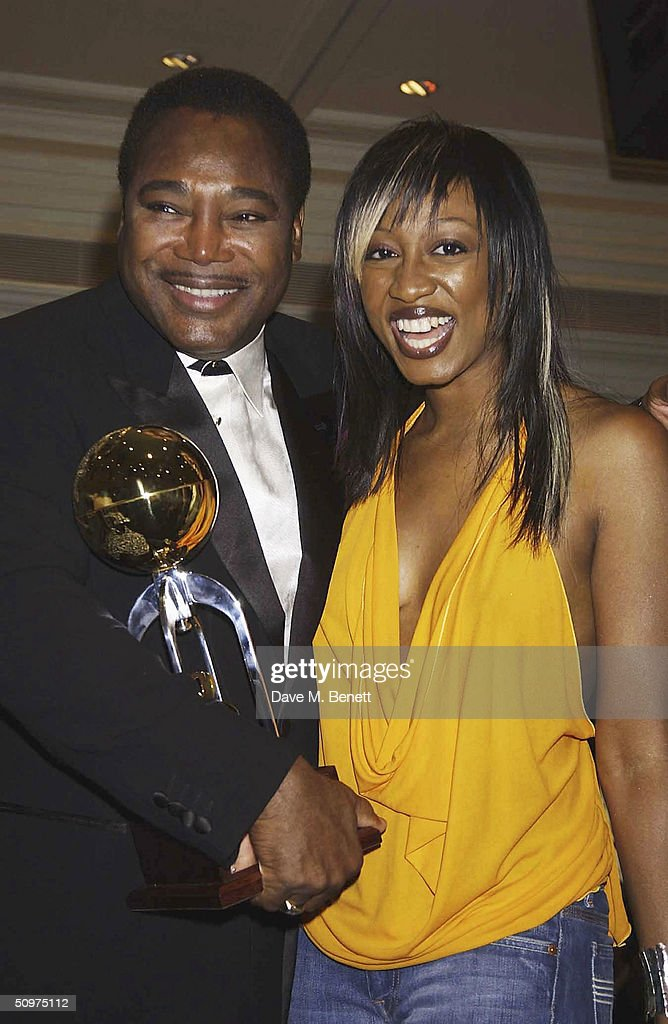 Singers George Benson and Beverley Knight pose with The Raymond Weil International Award at the Nordoff-Robbins O2 Silver Clef Awards at the Inter-Continental Hotel on June 18, 2004 in London.