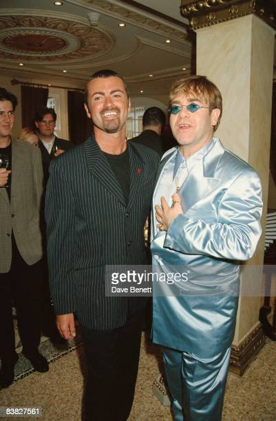 Singers George Michael and Elton John at the Gianni Versace 'Men Without Ties' launch party in London, 14th June 1995.
