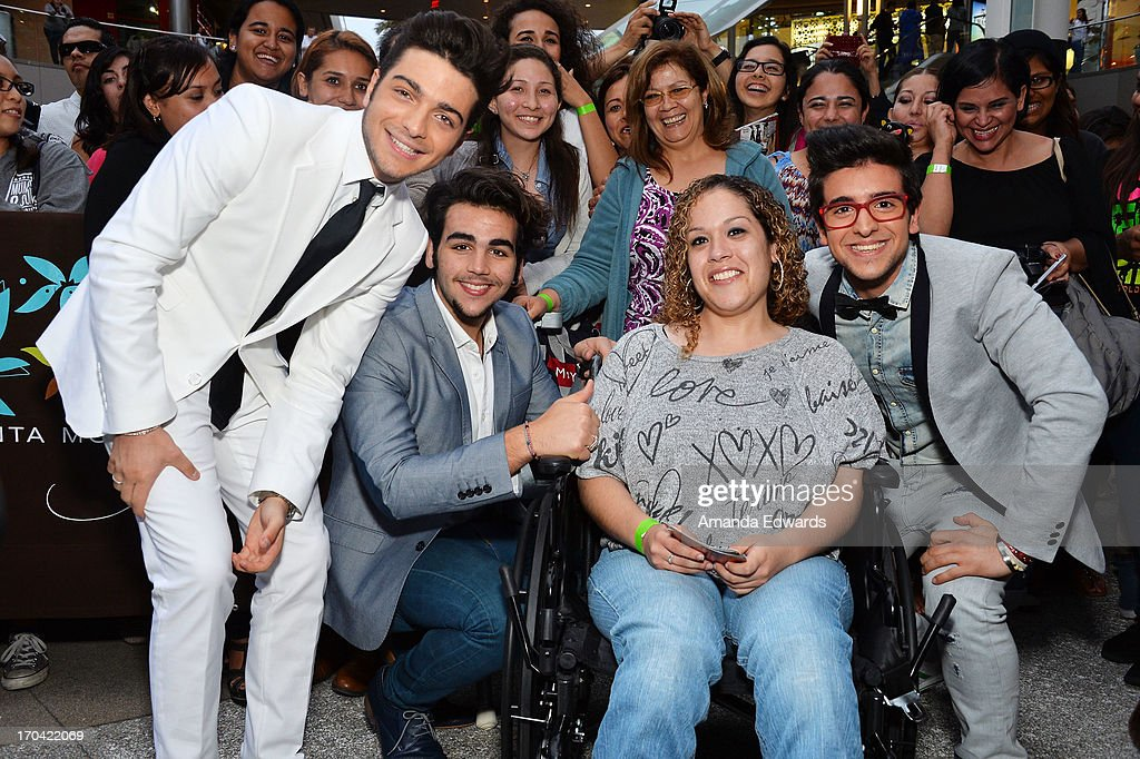 Singers Gianluca Ginoble, Ignazio Boschetto and Piero Barone of the group Il Volo greet fans before signing copies of their new album 'We Are Love' at Santa Monica Place on June 12, 2013 in Santa Monica, California.