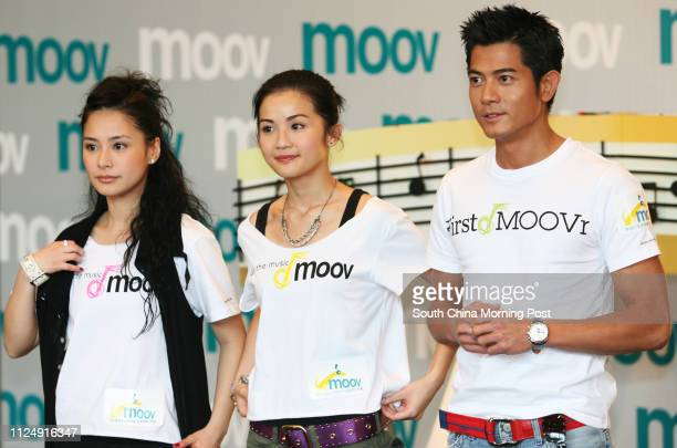 Singers Gillian Chung Yantung and Charlene Choi Cheukyin with actor Aaron Kwok Fushing at the press conference about PCCW launch an unlimited music...