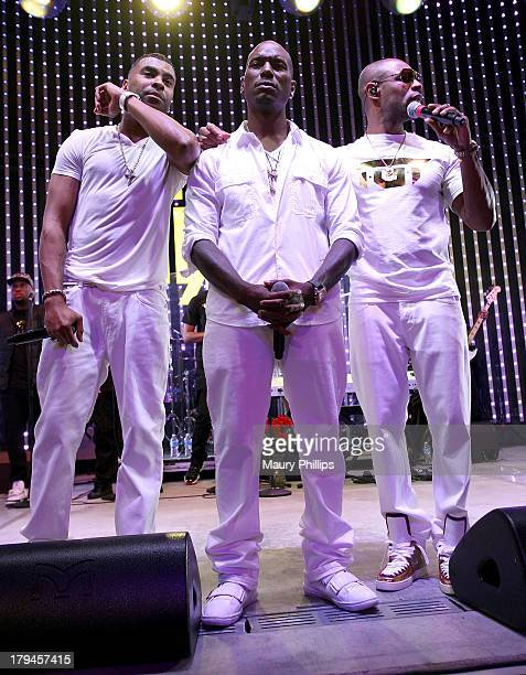 Singers Ginuwine Tyrese and Tank of RB Supergroup TGT perform at 5 Towers Outdoor Concert Arena on September 3 2013 in Universal City California
