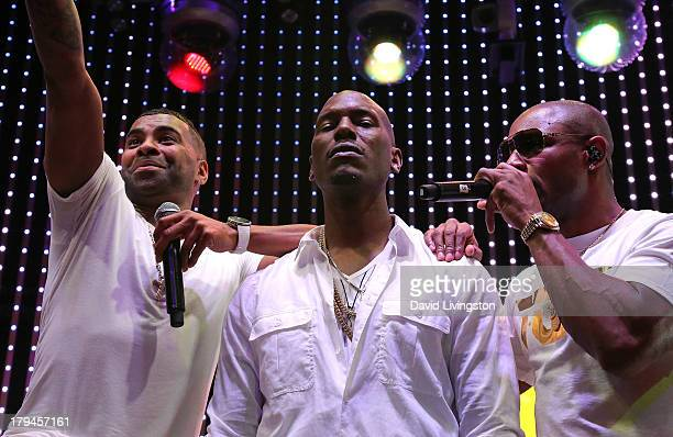 Singers Ginuwine Tyrese Gibson and Tank of TGT perform at the 5 Towers stage at Universal CityWalk on September 3 2013 in Universal City California