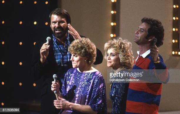 Singers Glen Campbell Anne Murray Barbara Mandrell and Larry Gatlin perform onstage in circa 1978