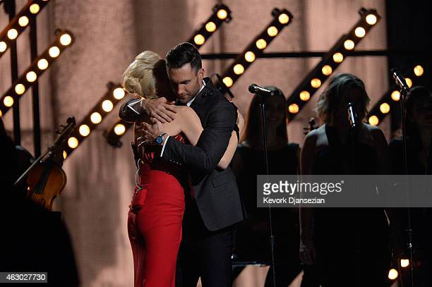 Singers Gwen Stefani and Adam Levine perform 'My Heart Is Open' onstage during The 57th Annual GRAMMY Awards at the at the STAPLES Center on February...