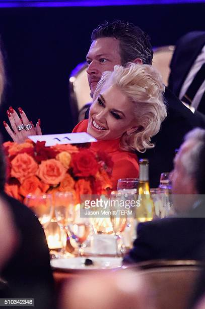 Singers Gwen Stefani and Blake Shelton attend the 2016 PreGRAMMY Gala and Salute to Industry Icons honoring Irving Azoff at The Beverly Hilton Hotel...
