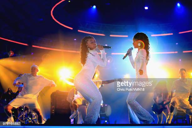 Singers Halle Bailey and Chloe Bailey of RB duo Chloe X Halle perfom onstage during the 2018 MTV Movie And TV Awards at Barker Hangar on June 16 2018...