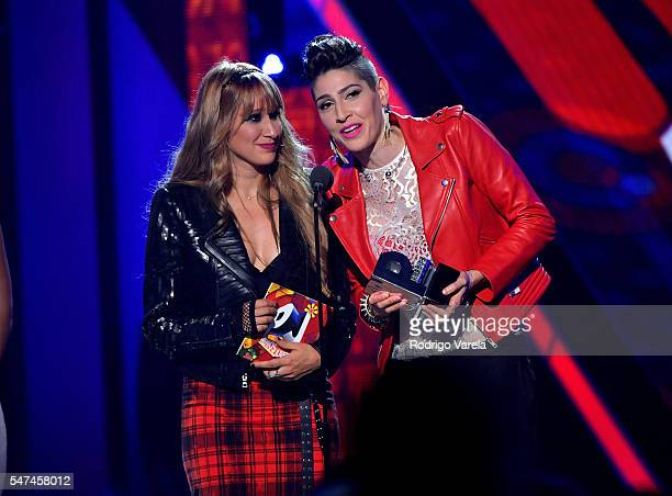 Singers Hanna Nicole Perez Mosa and Ashley Grace Perez Mosa of Ha*Ash recieve award onstage the Univision's 13th Edition Of Premios Juventud Youth...