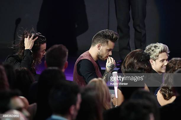 Singers Harry Styles Liam Payne and Niall Horan of One Direction accept Artist of the Year award onstage during the 2015 American Music Awards at...