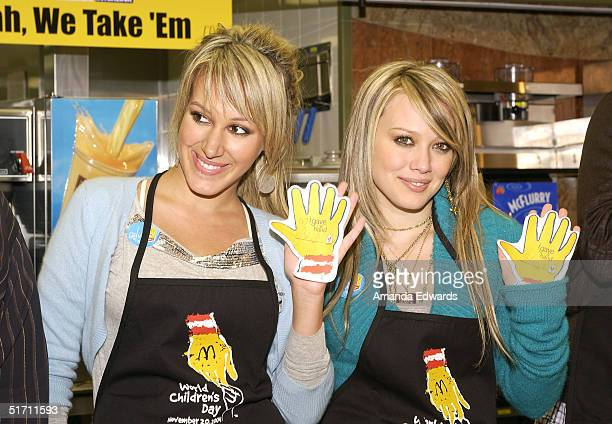 Singers Haylie and Hilary Duff 'give a hand' at the McDonald's World Children's Day on November 9 2004 at McDonald's in the Silverlake section of Los...