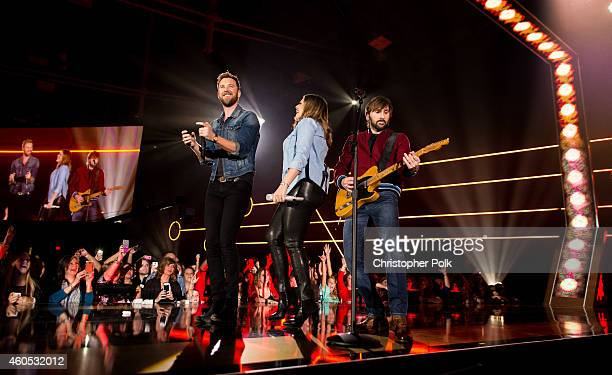 Singers Hillary Scott Charles Kelley and Dave Haywood of Lady Antebellum perform onstage during the 2014 American Country Countdown Awards at Music...