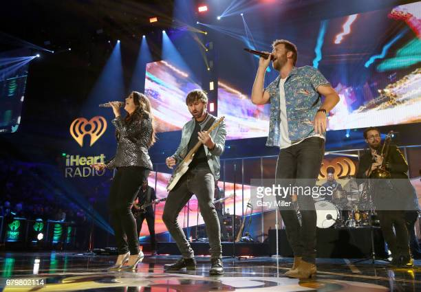 Singers Hillary Scott Dave Haywood and Charles Kelley of Lady Antebellum perform onstage during the 2017 iHeartCountry Festival A Music Experience by...