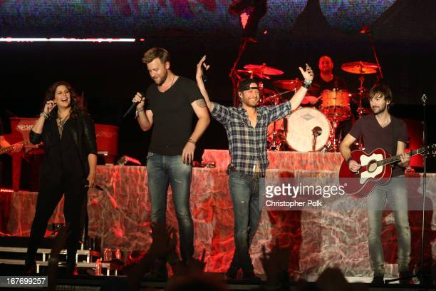Singers Hillary Scott Dierks Bentley Charles Kelley and Dave Haywood of Lady Antebellum perform onstage during 2013 Stagecoach California's Country...