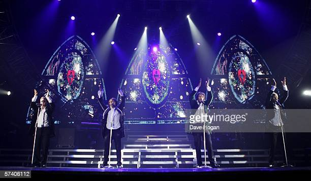 Singers Howard Donald Gary Barlow Mark Owen and Jason Orange of Take That perform on stage at the band's opening night of their 'Ultimate Tour 2006'...