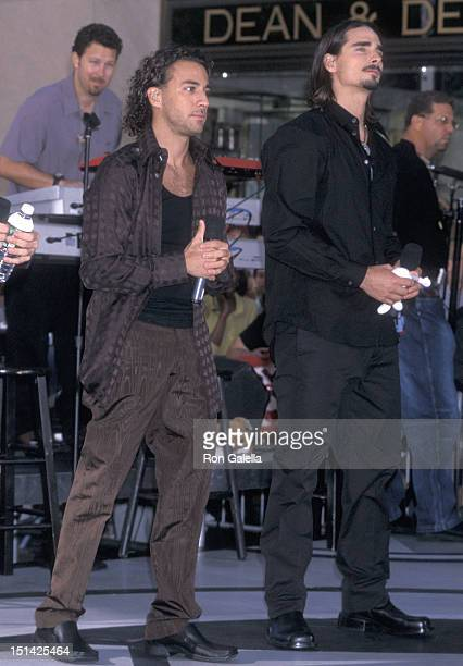Singers Howie Dorough and Kevin Richardson of the Backstreet Boys perform at 'The Today Show' Summer Concert Series on July 2 2001 at Rockefeller...