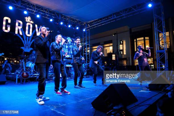 Singers Howie Dorough Brian Littrell Kevin Richardson Nick Carter and AJ McLean of the band Backstreet Boys perform onstage at the 2013 Grove Summer...