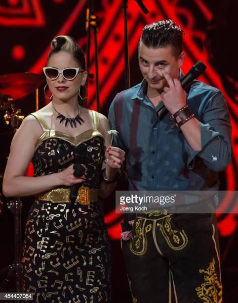Singers Imelda May and Andreas Gabalier perform during the TVShow 'Gabalier Die VolksRock'n'RollShow' on August 30 2014 in Fuessen Germany