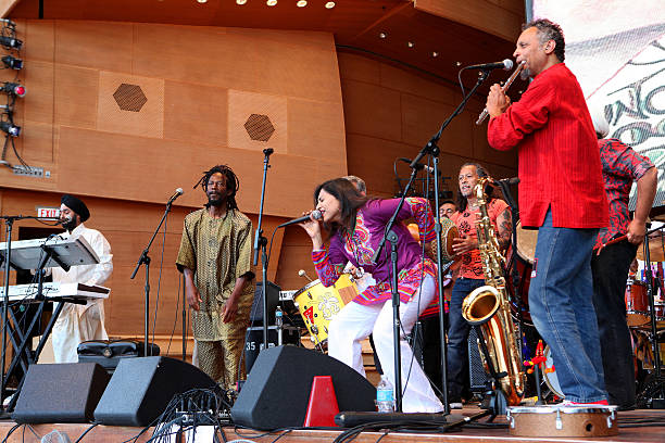 Singers Inder Paul Singh Valroy Dawkins and Pavithra and musicians Carlos Cornier and Lloyd King of Funkadesi performs at the Jay Pritzker Pavilion...