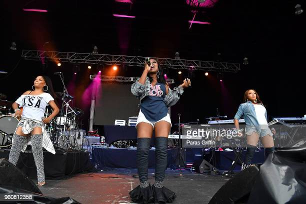 Singers Irish Grinstead Kameelah Williams and LaMisha Grinstead of 702 perform onstage at 2018 Funk Fest Tour at Wolf Creek Amphitheater on May 20...