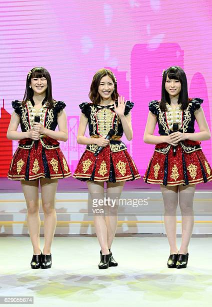 Singers Izuta rina, Mayu Watanabe and Saya Kawamoto of Japanese girl group AKB48 perform onstage during AKB48 fan meeting on December 10, 2016 in...