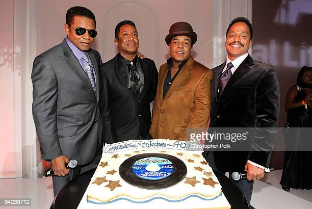 Singers Jackie Jackson Jermaine Jackson Tito Jackson and Marlon Jackson pose onstage during the AE launch of The Jacksons A Family Dynasty premiering...