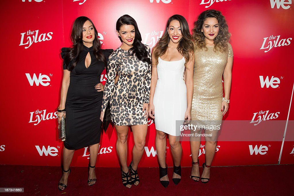 Singers Jaime Kailani, Tahiti Hernandez, Tiara Hernandez and Presley Hernandez of The Lylas attend WE tv's premiere party for 'The LYLAS' at Warwick on November 7, 2013 in Hollywood, California.